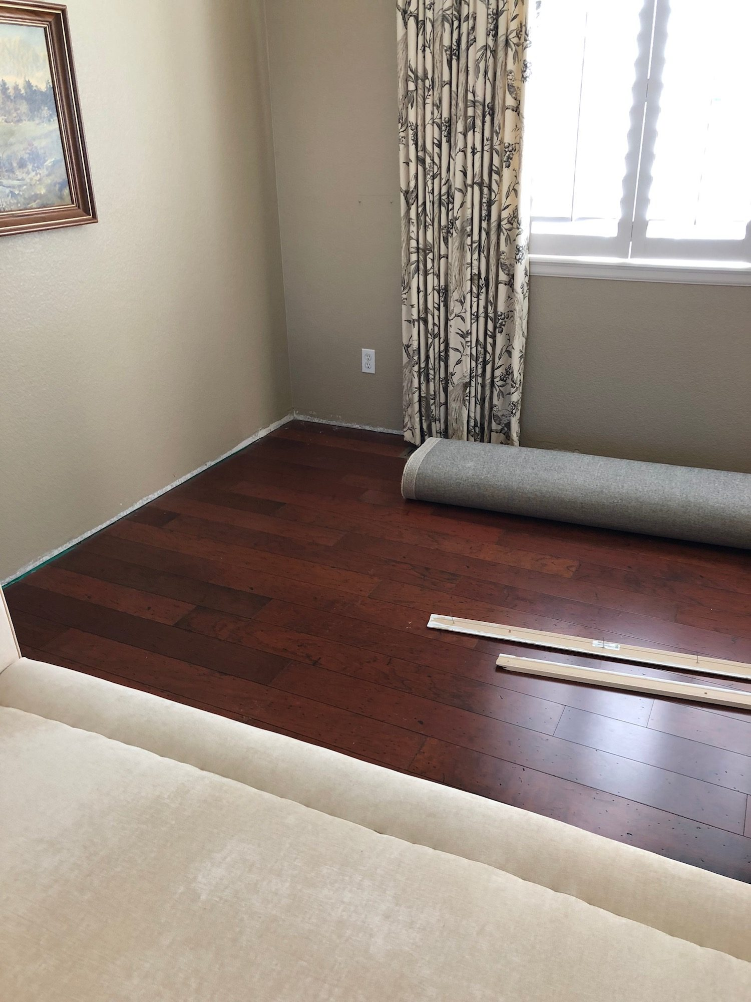 Wood flooring before and after picture