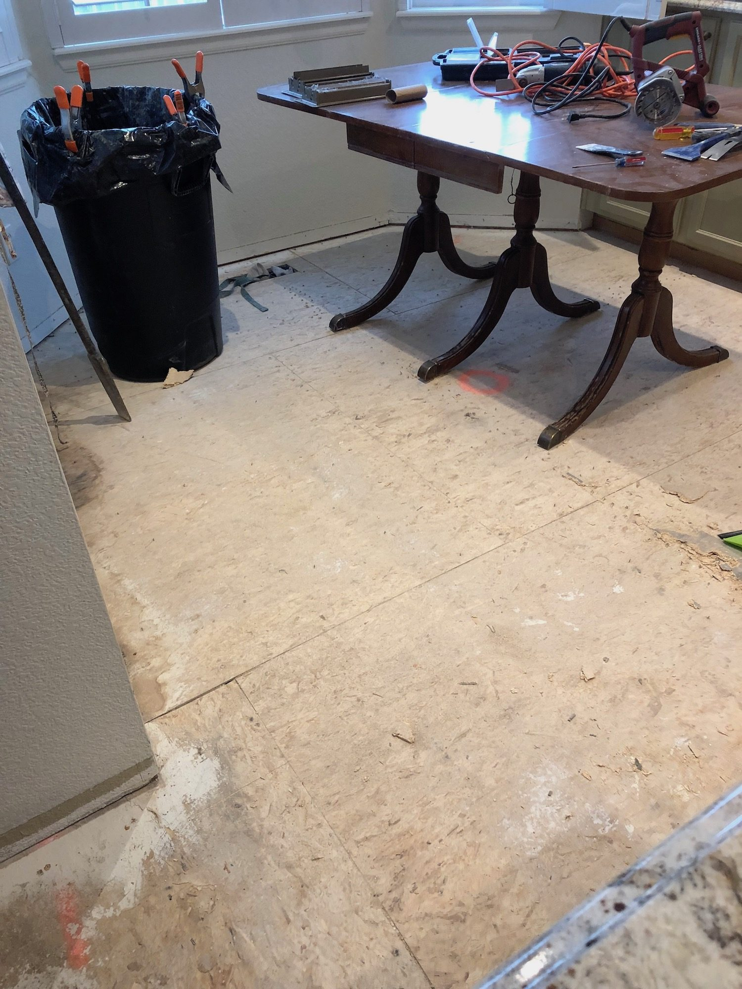 Demo begins: Tackling the  removal of the linoleum floors.